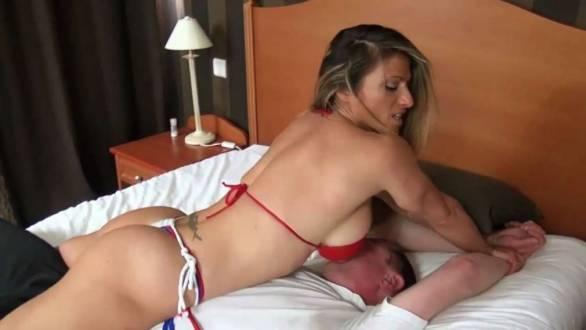 Sheila Rock dominating a guy in wrestling