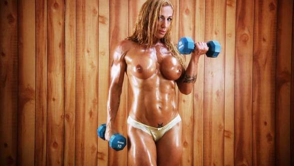 Victoria Lomba topless muscle bicep curls