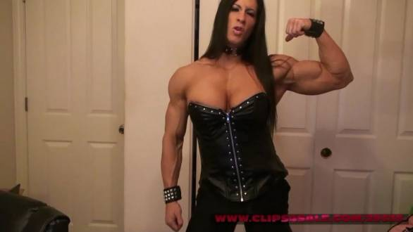 muscle girl pornstar Angela Salvagno flexing her big bicep
