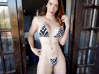 fit muscular woman on her webcam