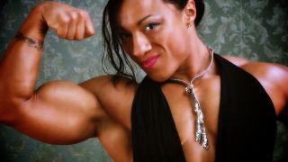 Karen Garrett flexing her huge bicep