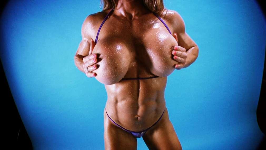 Muscular boobs dance