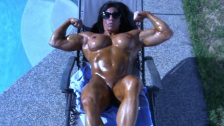Angela Salvagno nude covered in oil flexing her biceps