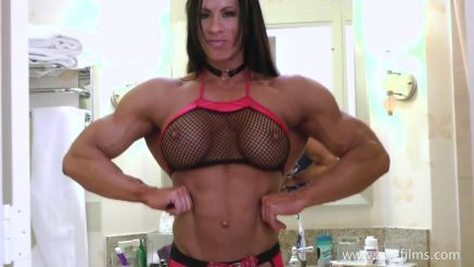 Angela Salvagno flexing her back and biceps