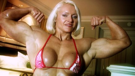 Brigita Brezovac flexing her thick biceps