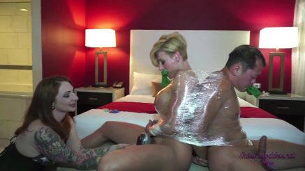 Goddess Rapture all tied up in plastic wrap.