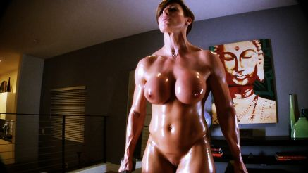Goddess Rapture covered in oil working out nude.
