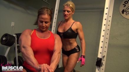 Two female bodybuilders working out.